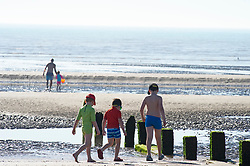 ©Licensed to London News Pictures 07/08/2020   <br /> St Mary's Bay, UK. Children walking on the beach. St Mary's Bay in Kent on the south coast is already starting to hot up with people arriving for a day on the beach. Scorching hot weather today in the UK as the heatwave weather looks set to continue into next week. Today could be one of the hottest on record if not the hottest. Photo credit: Grant Falvey/LNP