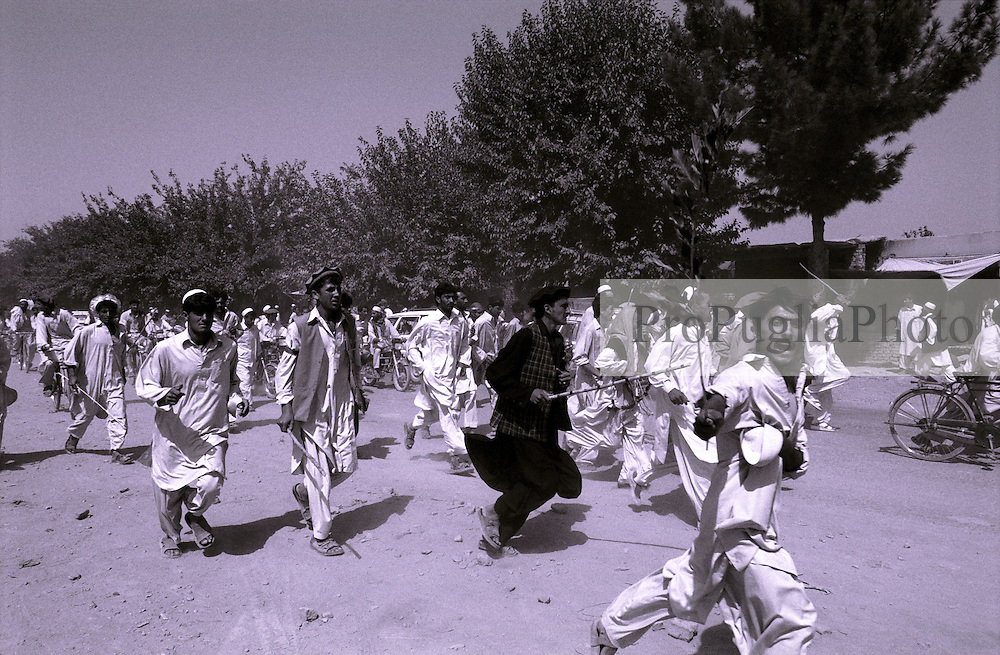 Afghan running on the street of Khost to prosted against the local airport extension's plan