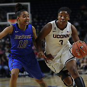 Morgan Tuck, (right), UConn, drives to the basket past Brittany Hrynko, DePaul, during the UConn Vs DePaul, NCAA Women's College basketball game at Webster Bank Arena, Bridgeport, Connecticut, USA. 19th December 2014
