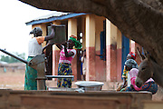 Women collecting water from one of the community water pumps in Tinguri, northern Ghana.