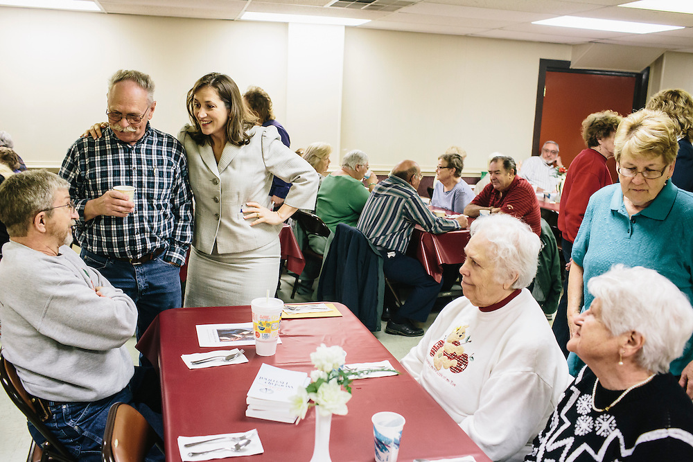 West Virginia Secretary of State Natalie Tennant talks with guests, including Ted Heckert, standing, and Kenneth Caplinger, far left, at Romney First United Methodist Church in Romney, W.V. during a Lenten Luncheon on Wednesday, April 16, 2014. Tennant is running for a US Senate seat in West Virginia against Republican Rep. Shelley Moore Capito.