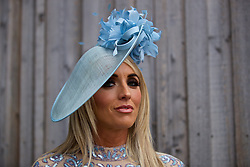 LIVERPOOL, ENGLAND - Thursday, April 6, 2017: Helen Foster, 22 from Liverpool, wearing a hat from Rodeo in Formby, during The Opening Day on Day One of the Aintree Grand National Festival 2017 at Aintree Racecourse. (Pic by David Rawcliffe/Propaganda)