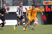 Mark Randall challenged by Robert Milsom during the EFL Sky Bet League 2 match between Newport County and Notts County at Rodney Parade, Newport, Wales on 6 May 2017. Photo by Daniel Youngs.