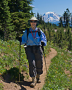 Hiking in Goat Rocks Wilderness Area, with a view of Mount Adams, Washington. For licensing options, please inquire.