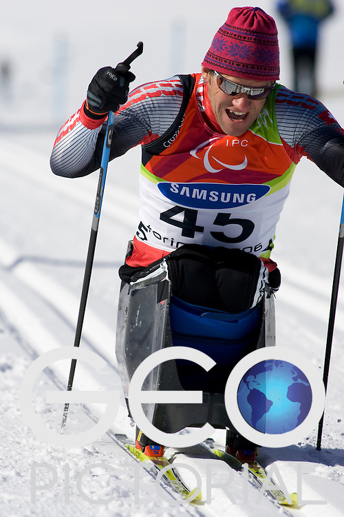 PRAGELATO PLAN, ITALY - MARCH 12: Ruedi Weber of Switzerland competes in the Mens Cross Country Skiing 5km Sitting on Day 2 of the 2006 Turin Winter Paralympic Games on March 12, 2006 in Pragelato Plan, Italy.