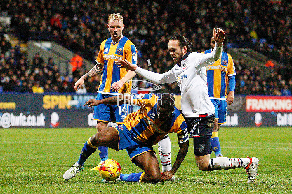 Shrewsbury's Abu Ogogo (8) holds off Bolton's Tom Thorpe (32) during the EFL Sky Bet League 1 match between Bolton Wanderers and Shrewsbury Town at the Macron Stadium, Bolton, England on 26 December 2016. Photo by Craig Galloway.