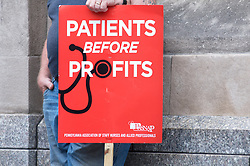 Protestor holds a sign ahead of a rally with Bernie2020 campaign co-chair Sen. Nina Turner, joined by local politicians and hospital workers protesting the imminent closure of Hahnemann University Hospital at a rally outside the Center City facilities in Philadelphia, PA on July 11, 2019.
