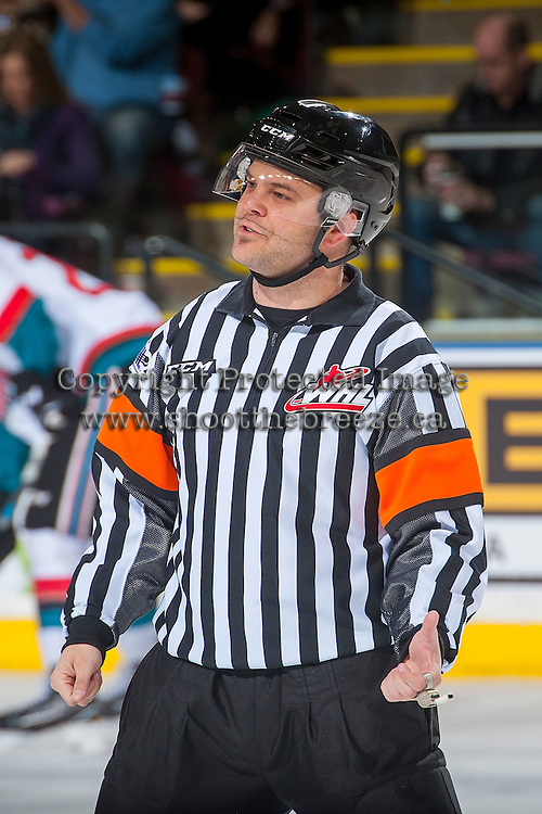 KELOWNA, CANADA - MARCH 4: Referee Chris Crich stands on the ice at the Kelowna Rockets against the Tri-City Americans on March 4, 2017 at Prospera Place in Kelowna, British Columbia, Canada.  (Photo by Marissa Baecker/Shoot the Breeze)  *** Local Caption ***