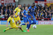 Tom Elliott forward for AFC Wimbledon (9) evades Seamus Conneely midfielder Accrington Stanley (28) challenge during  the Sky Bet League 2 Play-Off first leg match between AFC Wimbledon and Accrington Stanley at the Cherry Red Records Stadium, Kingston, England on 14 May 2016. Photo by Stuart Butcher.