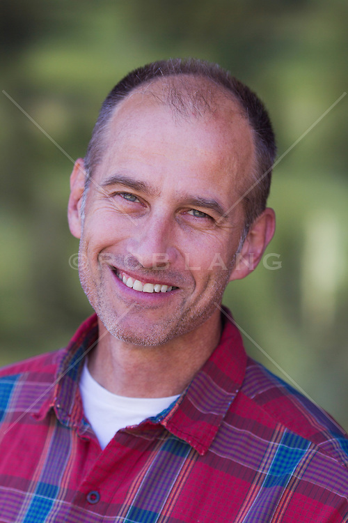 portrait of a good looking fifty something man with thinning hair