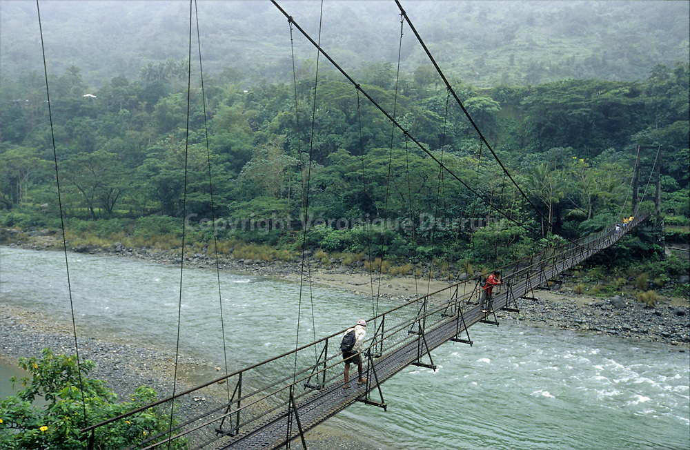 HANGING BRIDGE NEAR TINGLAYEN,  KALINGA PROVINCE, NORTH LUZON, THE PHILIPPINES