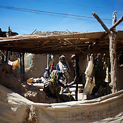 January 21, 2013 - Diabaly, Mali: Local merchants at a stall in Diabaly market, a day after Mali government troops regain control of the city. Diabaly was under islamist militants control since the 14th of January...Several insurgent groups have been fighting a campaign against the Malian government for independence or greater autonomy for northern Mali, an area known as Azawad. The National Movement for the Liberation of Azawad (MNLA), an organisation fighting to make Azawad an independent homeland for the Tuareg people, had taken control of the region by April 2012...The Malian government pledge to the French army to help the national troops to stop the rebellion advance towards the capital Bamako. The french troops started aerial attacks on rebel positions in the centre of the country and deployed several hundred special forces men to counter attack the advance on the ground. (Paulo Nunes dos Santos/Polaris)