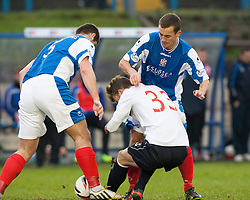 Falkirk's Rory Loy between Cowdenbeath's John Armstrong and Cowdenbeath's Aaron Lynas.<br /> half time : Cowdenbeath 0 v 0 Falkirk, Scottish Championship game today at Central Park, the home ground of Cowdenbeath Football Club.<br /> &copy; Michael Schofield.