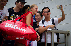 September 22, 2018 - Kristina Mladenovic signs autographs at the 2018 Dongfeng Motor Wuhan Open WTA Premier 5 tennis tournament (Credit Image: © AFP7 via ZUMA Wire)
