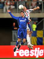 30-08-2008 VOETBAL:WILLEM II:AJAX:TILBURG<br /> Danny Schenkel is Klaas Jan Huntelaar de baas in een luchtduel<br /> Foto: Geert van Erven