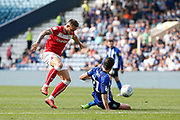 George Boyd of Sheffield Wednesday challenges Josh Brownhill of Bristol City during the EFL Sky Bet Championship match between Sheffield Wednesday and Bristol City at Hillsborough, Sheffield, England on 22 April 2019.