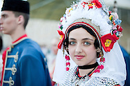 Brodsko kolo, Slavonski Brod, Croatia (9 June 2013). Young woman from Sonta, near Sombor in Vojvodina, Serbia, in traditional folk costume. The Brodsko kolo, now in its 49th year, is the oldest folk dancing festival in Croatia.