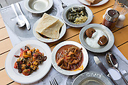 Lamb bean stew, falafel, yoghurt, bread, stuffed vine leaves, at Ciya Sofrasi Turkish restaurant Asian Istanbul, Turkey