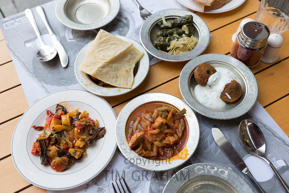 Lamb bean stew, falafel, yoghurt, bread, stuffed vine leaves, at Ciya Sofrasi Turkish restaurant Asian Istanbul, Turkey