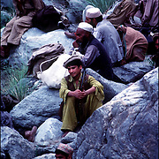 Mujihadeen fighters rest as they cross the Hindu Kush mountains while fighting the Russians in 1982