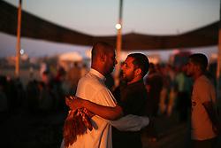 June 15, 2018 - Gaza, Palestinian Territories, Palestine - Palestinians attend Eid al-Fitr prayers in Khan Younis in the southern Gaza Strip June 15, 2018. (Credit Image: © Majdi Fathi/NurPhoto via ZUMA Press)