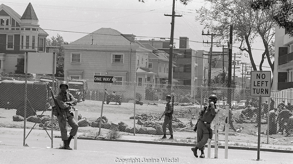 National Guard behind 8 foot wire fences during People's Park Student protest & riots in Berkeley California 1969