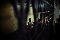 A gang member in the holding cell at the Supreme Court of Justice, in Guatemala City, on Wednesday, March 21, 2012. Mexican drug cartels are new players in a complex mix of paramilitary and vigilante groups in the shadowlands between state and organized crime in Guatemala, a transit point for cartels transporting drugs from Colombia to the United States. With a near 99% impunity and a homicide rate that is twice as high then Mexico (per 100,000), some critics say Guatemala is on the verge of becoming a failed state.