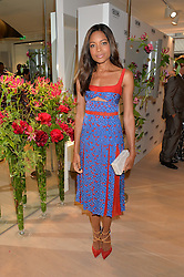 NAOMIE HARRIS at the launch of the new Rimowa store at 153a New Bond Street, London on 29th June 2016.