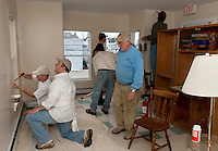 "As part of the ""Adopt a Room"" program David Pereira and Jim Sherman repair walls with spackle while fellow Gilford Rotarians Spencer Martin, Dale Squires, John Jude and Mike Warmington apply a fresh coat of paint to the walls of the Family Room at the Carey House in Laconia.  (Karen Bobotas/for the Laconia Daily Sun)"