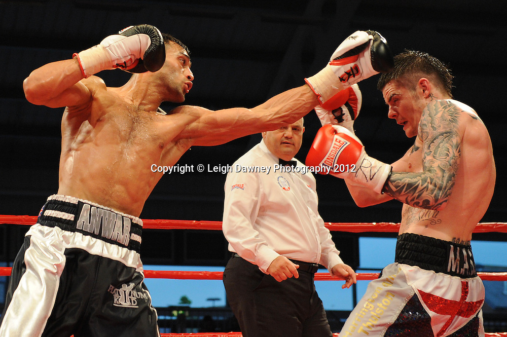 Adil Anwar (left) defeats Dave Ryan in a 10x3 Light Welterweight contest at the Aintree Equestrian Centre, Liverpool on the 19th May 2012. Frank Maloney Promotions © Leigh Dawney Photography 2012.