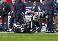 American Football - 2019 NFL Season (NFL International Series, London Games) - Houston Texans vs. Jacksonville Jaguars<br /> <br /> Jordan Akins, Tight End, (Houston Texans) tackled by Myles Jack, Middle Linebacker, (Jacksonville Jaguars) at Wembley Stadium.<br /> <br /> COLORSPORT/DANIEL BEARHAM