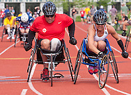 West Point, New York - Army's Kelly Elmlinger, right, edges Army's Dan Hendrix at the finish line of their heat of the wheelchair 100-meter dash at the United States Military Academy Preparatory School on Tuesday, June 17, 2014.<br />