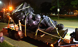 August 16, 2017 - Baltimore, Maryland, U.S. - A monument dedicated to the Confederate Women of Maryland lies on a flatbed trailer near the intersection of Charles St. and University Parkway early Wednesday morning after it was taken down. (Credit Image: © Jerry Jackson/TNS via ZUMA Wire)