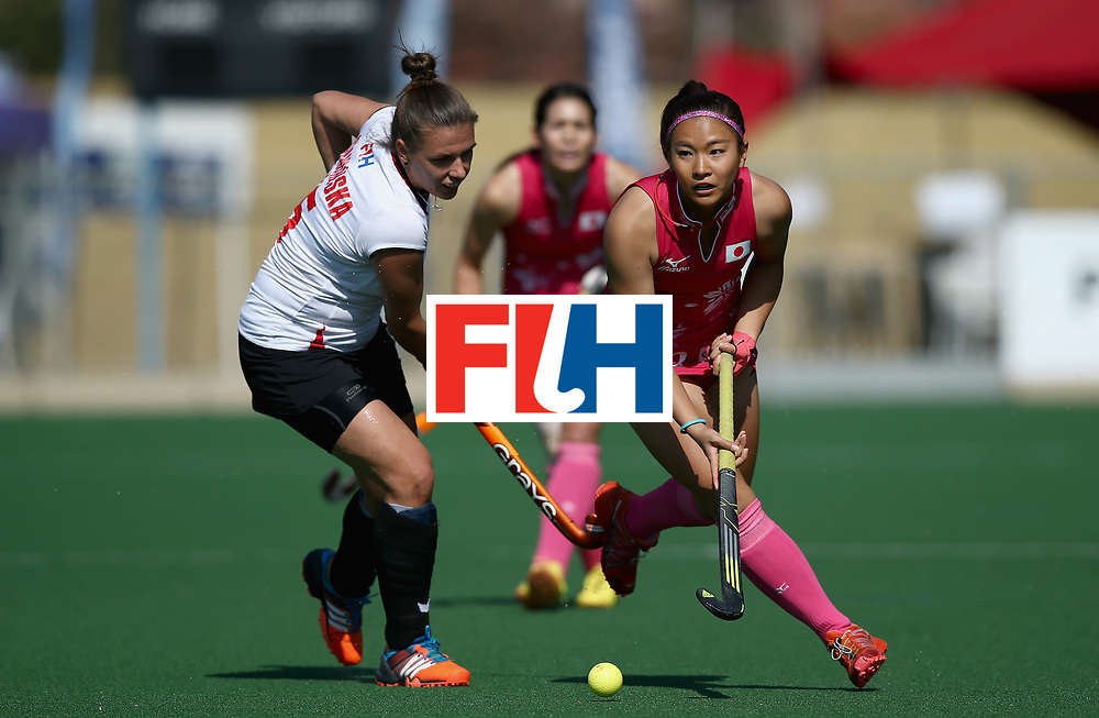 JOHANNESBURG, SOUTH AFRICA - JULY 14: Maho Segawa of Japan and Paula Slawinska of Poland battle for possession during day 4 of the FIH Hockey World League Semi Finals Pool B match between Poland and Japan at Wits University on July 14, 2017 in Johannesburg, South Africa. (Photo by Jan Kruger/Getty Images for FIH)