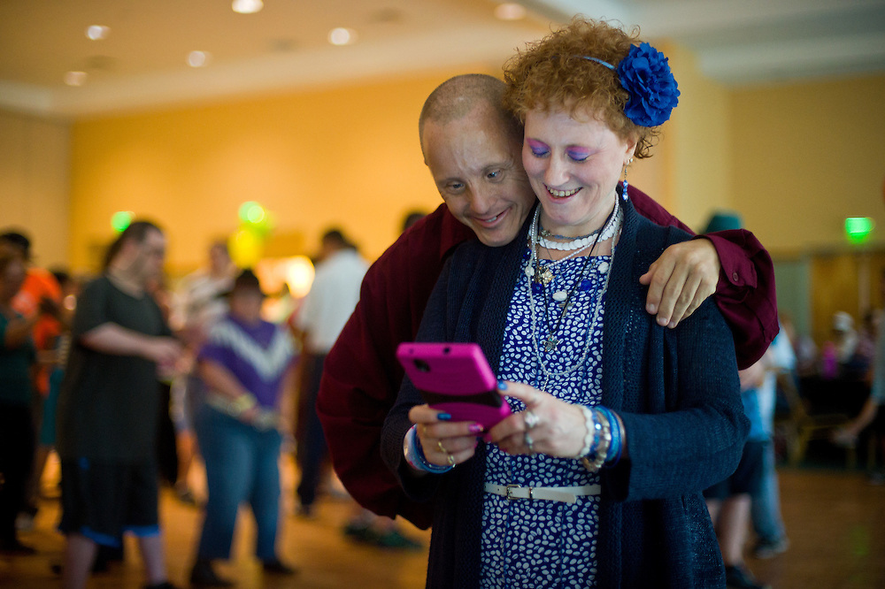 "Xavier Mascareñas/Treasure Coast Newspapers; Audra Frashure and Bob Bessette, both of Port St. Lucie, take a selfie break on the dance floor during ""Dancin' thru the Decades"" on Aug. 20, 2015, at the Port St. Lucie Civic Center. ""We're having a good time, an awesome time,"" Frashure said. ""I'm dancing with some people that I know, and some boys that know me."" The City of Port St. Lucie Special Recreation group held the event for residents with special needs and their caregivers, family and friends."