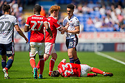 Nottingham Forest midfielder Jack Colbeck (18) argues with Bolton Wanderers defender Antonee Robinson (15) after fouling Reds team-mate Nottingham Forest forward Joe Lolley (23) during the EFL Sky Bet Championship match between Bolton Wanderers and Nottingham Forest at the Macron Stadium, Bolton, England on 6 May 2018. Picture by Jon Hobley.