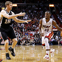 17 January 2012: Miami Heat point guard Norris Cole (30) drives past San Antonio Spurs power forward Matt Bonner (15) during the Miami Heat 120-98 victory over the San Antonio Spurs at the AmericanAirlines Arena, Miami, Florida, USA.