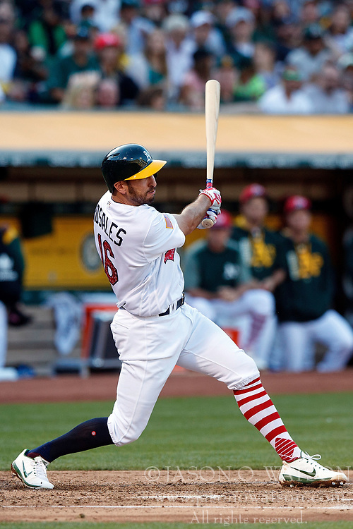 OAKLAND, CA - JULY 03:  Adam Rosales #16 of the Oakland Athletics hits a two run single against the Chicago White Sox during the second inning at the Oakland Coliseum on July 3, 2017 in Oakland, California. (Photo by Jason O. Watson/Getty Images) *** Local Caption *** Adam Rosales