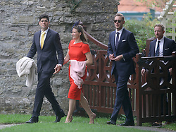 England cricket player Alastair Cook (left) with his wife Alice, and Stuart Broad (second right) and Paul Collingwood arrive at St Mary the Virgin, East Brent, Somerset, for the wedding of Ben Stokes and his fiancee Clare Ratcliffe.