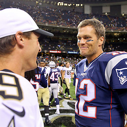 Aug 22, 2015; New Orleans, LA, USA; New England Patriots quarterback Tom Brady (12) and New Orleans Saints quarterback Drew Brees (9) following a preseason game at the Mercedes-Benz Superdome. Mandatory Credit: Derick E. Hingle-USA TODAY Sports