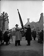 30/11/1952<br /> 11/30/1952<br /> 30 November 1952<br /> Presentation of new colours to 1st Battalion old IRA by F. Thornton to Jimmy Brennan.
