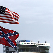 An American flag flies above a Confederate flag during the 57th Annual NASCAR Coke Zero 400 practice session at Daytona International Speedway on Friday, July 3, 2015 in Daytona Beach, Florida.  (AP Photo/Alex Menendez)