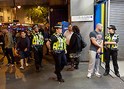 Sadia Khan at London's Night Tube launch at Brixton tube station, London, Great Britain <br /> 19th August 2016 <br /> <br /> British Transport Police on duty at the station <br /> <br /> Sadia Khan, mayor of London,  launched the first night tube service and travelled on a tube train between Brixton and Walthamstow on the Victoria Line. <br />  <br /> He launched the first 24 hour Friday and Saturday night services on the Central and Victoria lines <br /> <br /> Photograph by Elliott Franks <br /> Image licensed to Elliott Franks Photography Services