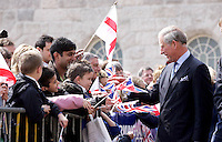 Pictured are visitors and pupils from Birmingham welcoming the arrival of HRH Prince Charles the Prince of Wales and his wife Camila the Duchess of Cornwall. He is pictured talking to a pupils from pupils from St Edwards Catholic School in Selly Park Birmingham. They are opening Birmingham's refurbished Town Hall<br />