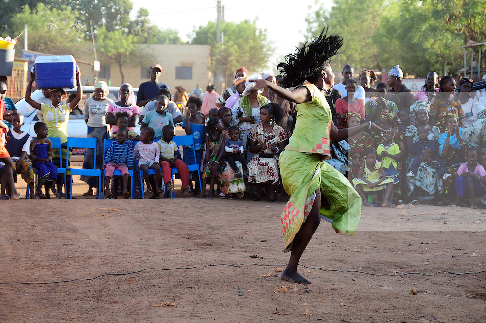 A dancer celebrate the 13th anniversary of the association for the defence of the rights of women of Banakabougou, a Bamako district.