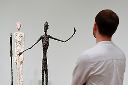 "© Licensed to London News Pictures. 08/05/2017. London, UK. A staff member view ""Man Pointing"", 1947.  Preview of the UK's first major retrospective of Alberto Giacometti for 20 years at Tate Modern.  The exhibition runs 10 May to 10 September 2017. Photo credit : Stephen Chung/LNP"