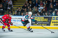 KELOWNA, CANADA - APRIL 8: Caleb Jones #3 of the Portland Winterhawks stick checks Nick Merkley #10 of the Kelowna Rockets as he skates with the puck on April 8, 2017 at Prospera Place in Kelowna, British Columbia, Canada.  (Photo by Marissa Baecker/Shoot the Breeze)  *** Local Caption ***