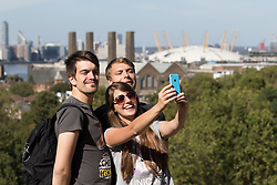© Licensed to London News Pictures. 11/09/2016. LONDON, UK.  A group of tourists take a selfie in front of the O@ during hot and sunny autumn weather in Greenwich Park, south east London today.  Photo credit: Vickie Flores/LNP