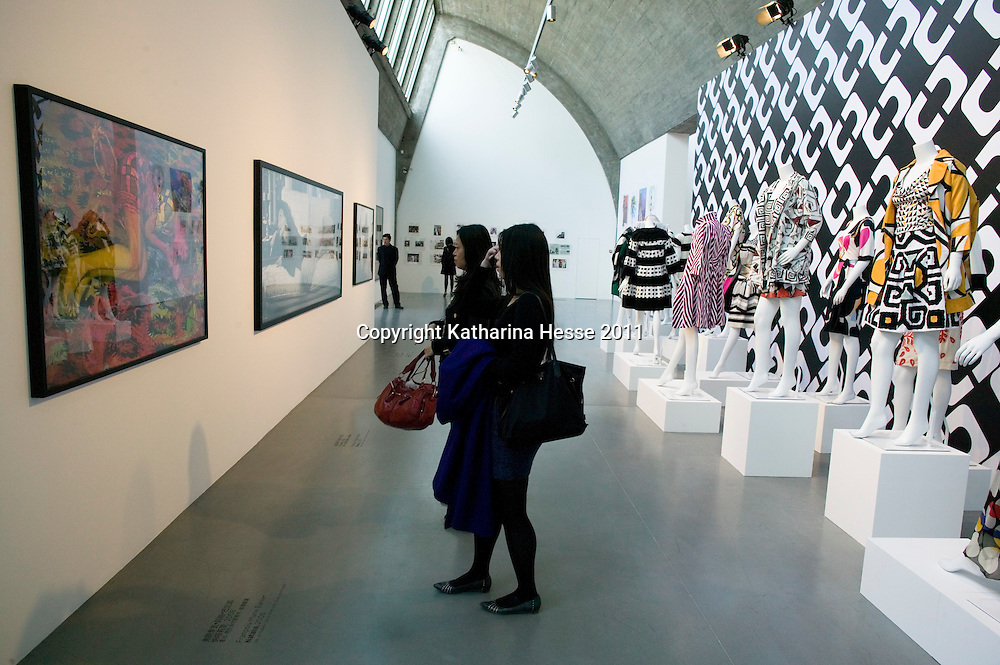 "Beijing, April,2, 2011 : visitors look at art work displayed at the "" Journey of a Dress "" exhibition in Beijing."