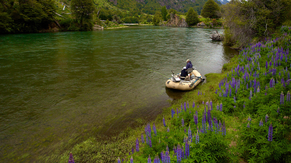 Taking a break during a float trip on the Rip Manuheles near Coyaique, Chile. The month of March brings mild weather and an explosion of wildflowers.